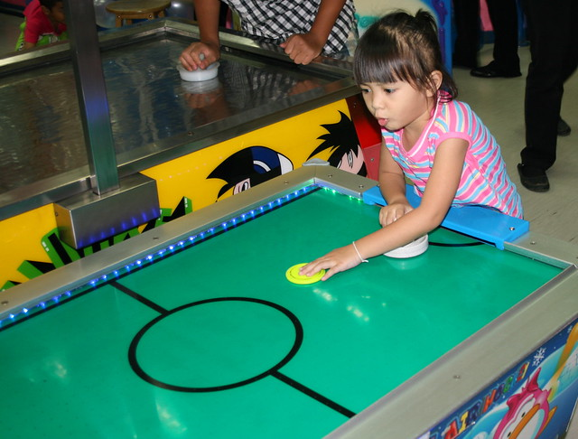 Ja Playing Air Hockey