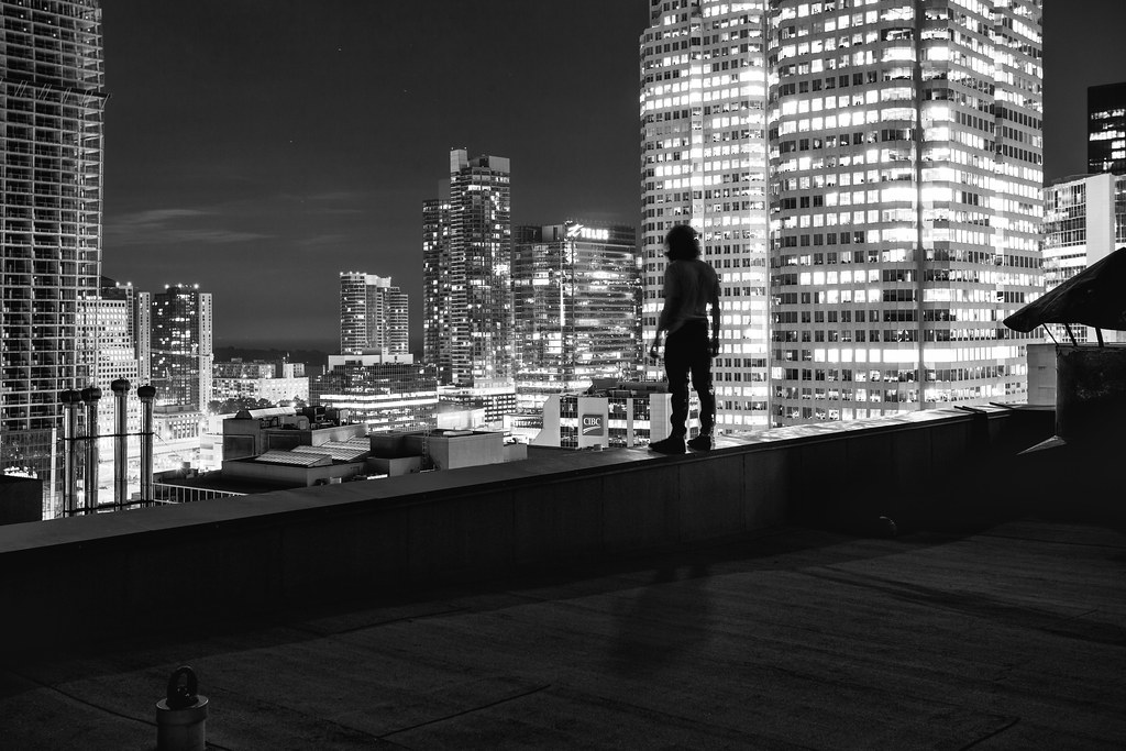 black and white image of silhouette portrait rooftopping in toronto at night