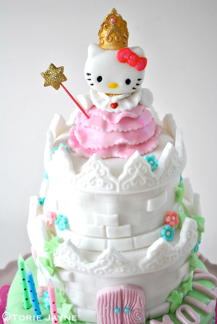 Princess Hello Kitty atop her castle cake