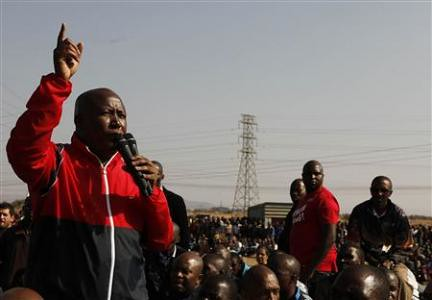 Expelled African National Congress Youth League President Julius Malema addressing the striking mineworkers at Marikana where a massacre of 34 workers took place on August 16, 2012. Malema was speaking on August 18. by Pan-African News Wire File Photos