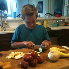 Big bro chopping veggies! #kidsinthekitchen #homeschool