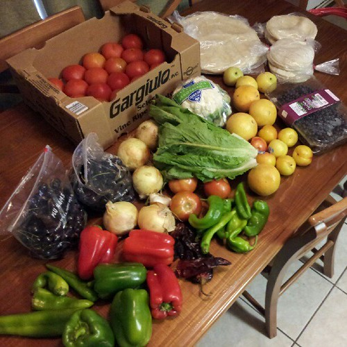 #BountifulBasket this week with added fajita veggie pack, tortillas, & tomatoes: 3 green & 3 red bell peppers, 9 hatch chili's, 5 yellow onions, 1 garlic, 5 dried chili's, 13 lbs of tomatoes, 2 bags of cherries, head of romaine, cauliflower, brussel sprou