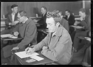 Close-up of an applicant for employment with the TVA taking the examination for skilled and unskilled labor at the high school building, Clinton, Tennessee, November 1933