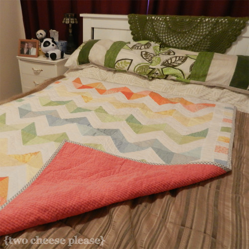 zig zag quilt lying on a double bed