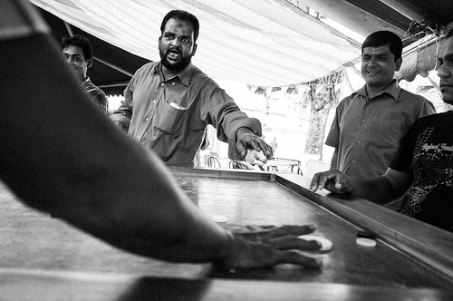 Man protesting over a game of carrom, Little India, Singapore