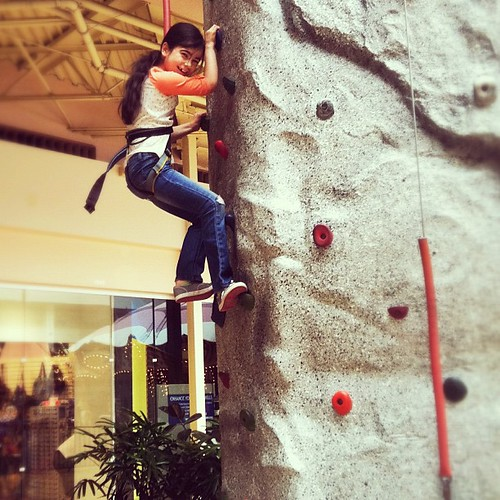 Proud of my girl today for making it all the way up that rock wall. :)