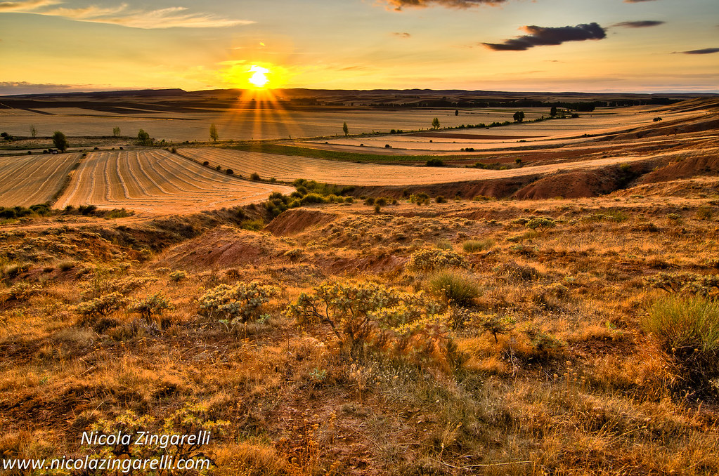 Spanish Landscape With The Sun Low On The Horizon Hdr A