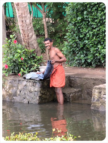 kerala backwaters guy doing laundry