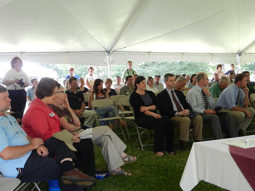 on left - Judith Canales, Acting Deputy Under Secretary for Rural Development in front row with Gregg MacPherson, Area Director and Molly Lambert, State Director – on right – congressional staff Ivey Jones-Congressman Bass, Sean Thomas-Congressman Guinta, Matt Leahy-Senator Shaheen, and Simon Thompson-Senator Ayotte with community attendees at the New Hampshire 150th USDA Anniversary Observance.