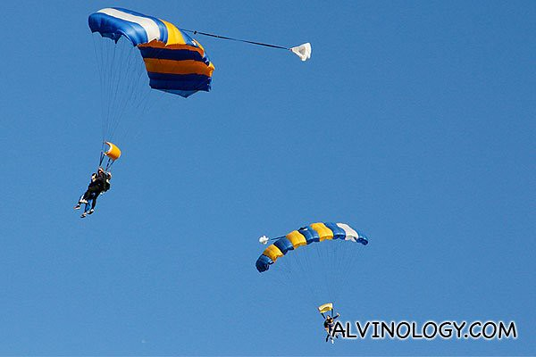 Other people landing their parachutes