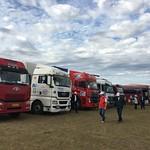 caravan-mongolia-parked trucks-field