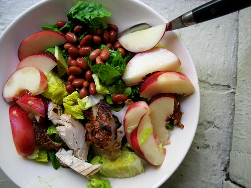 green salad with chicken, pinto beans, and nectarines