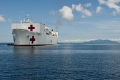 In this file photo, USNS Mercy sits off the Philippines coast during a previous Pacific Partnership mission. (U.S. Navy/MC3 Michael Feddersen)