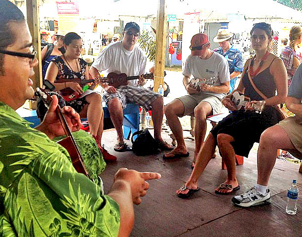 <p>People from all over the world learn how to play the ukulele at the University of Hawaii exhibit at the Smithsonian Folklife Festival.</p>