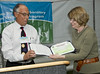 "George Rael presenting a bronze award for ""green"" purchasing to Laboratory Deputy Director Beth Sellers."
