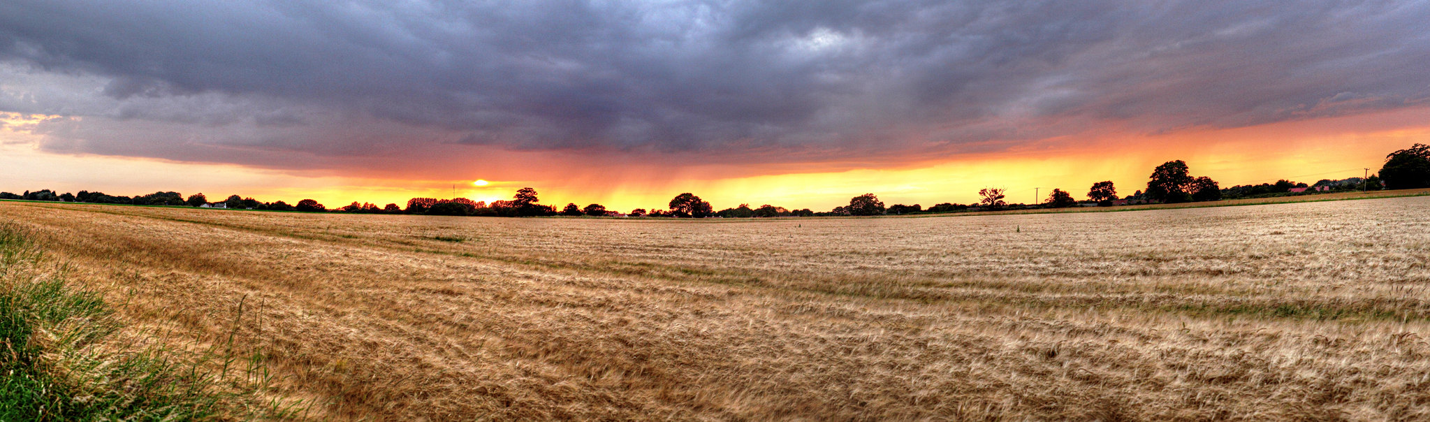 A panorama of the sunset through the storm clouds over the Essex countryside - photo of fields near the Essex Lion, Clacton