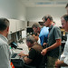Researchers from LANL and the French Space Agency examine data from the Mars Science Laboratory Curiosity rover from inside the ChemCam Operations Center at NASA's Jet Propulsion Laboratory on Monday, Aug. 6, 2012, less than a day after the rover landed on Mars. The ChemCam team received signals indicating that the instrument is healthy and all systems are ready to go.