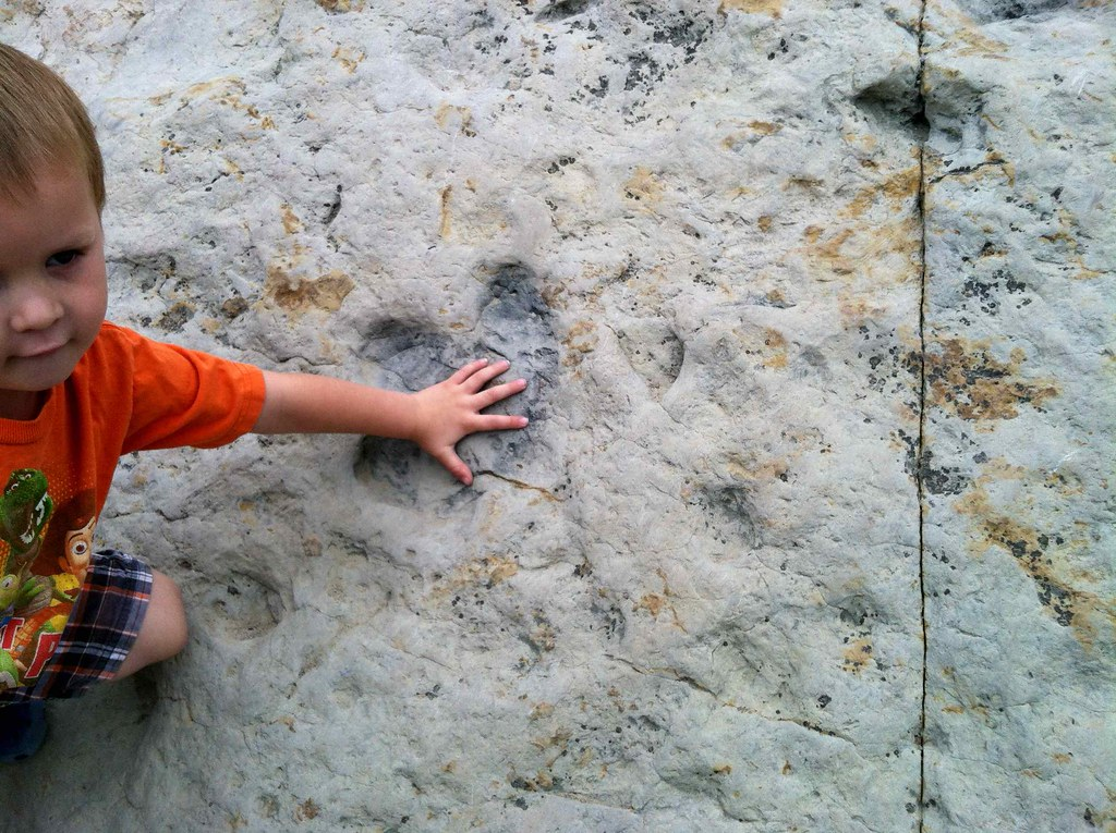 little Hunter with a baby inguanadon footprint