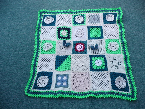 I've just finished this blanket. I love it! Thanks to everyone that has contributed squares!