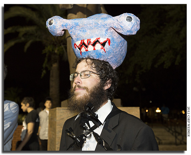Nathan Pim - who fashioned the predatory capitalists' headpieces for the roving dance party -wears the head of a shark