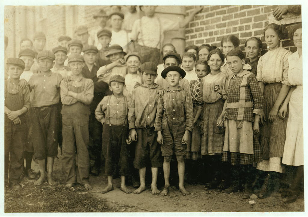 Groups of workers in Clayton (N.C.) Cotton Mills. Every one went in to work when whistle blew, and I saw most of them at work during the morning when I went through. Mr. W.H. Swift talked with a boy recently who said he was ten years old and works in the Clayton Cotton Mill, also that others the same age worked. Here they are. I couldn't get the youngest girls in the photos. Clayton is but a short ride from the State Capitol. (The Superintendent watched the photographing without comment.) Clayton, North Carolina.