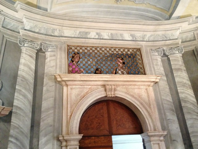 Some Women's Voices Chorus members visit the upper gallery in the Sala della Musica