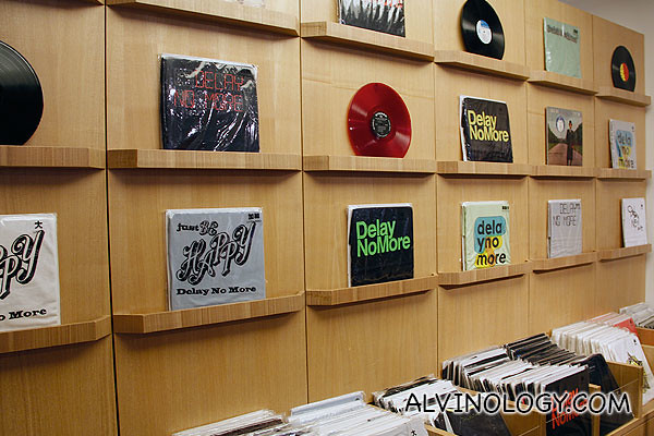 Tee-shirts displayed like vinyl records