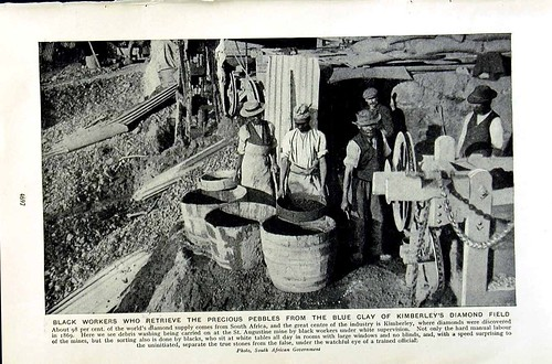 A black and white photo of black diamond workers. Caption below.