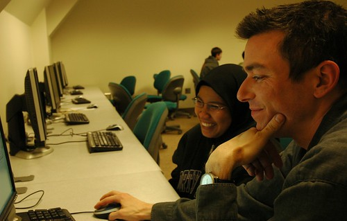 All smiles, Instructor Jim Loter with a student, after class answering questions, computer lab, Infomatics, iSchool, University of Washington, USA by Wonderlane
