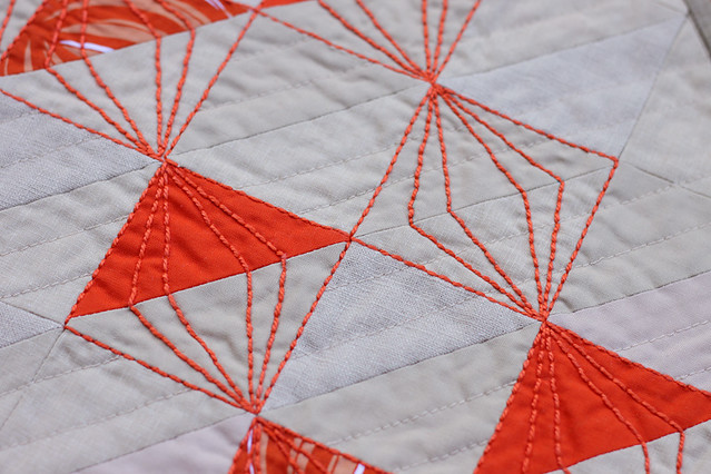 orange hand quilting in a diamond shape