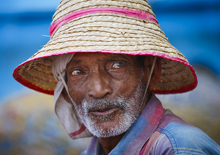 Portrait Of An Old Fisherman Wearing A Straw Hat, Mahe, India