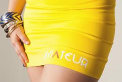 orange(0.0), swimsuit bottom(0.0), active undergarment(0.0), abdomen(0.0), trunk(0.0), human body(0.0), swimwear(0.0), shorts(0.0), arm(1.0), clothing(1.0), yellow(1.0), limb(1.0), skort(1.0), thigh(1.0),
