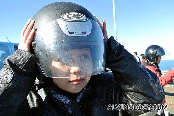 June from Razor TV putting on her helmet