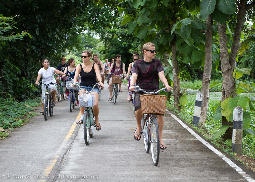 Smart Cook Thai Cookery School students cycle to the classroom at Baan Pasao