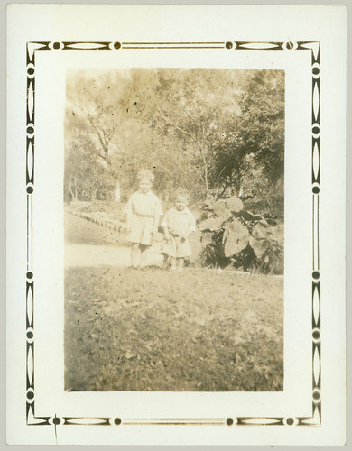 Two children in a garden