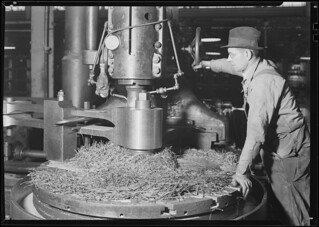 Railroad parts. Baldwin Locomotive Works. Machinist milling down part of a drive-shaft on big locomotive, March 1937