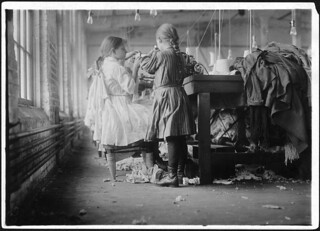 Two of the tiny workers, a raveler and a looper in London Hosiery Mills. London, Tenn, December 1910