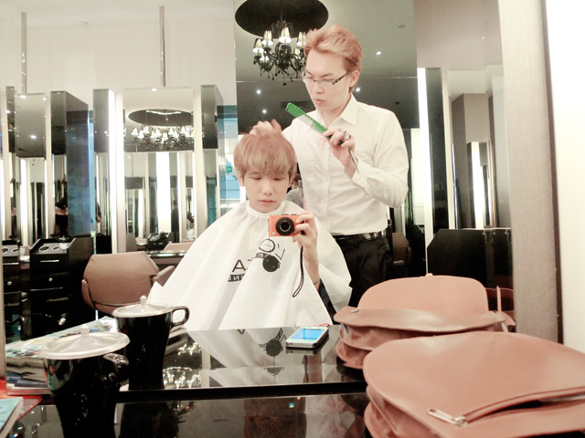 typicalben having hair cut at action hair salon