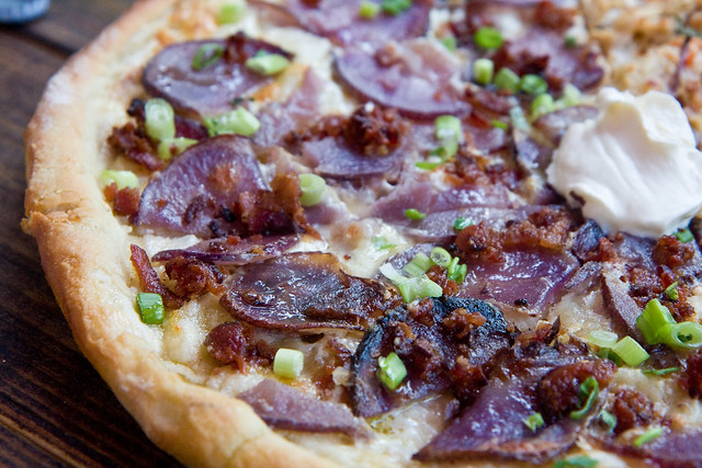 Baked potato pizza with creme fraiche, white cheddar, bacon, and green onions, Pete Zaaz