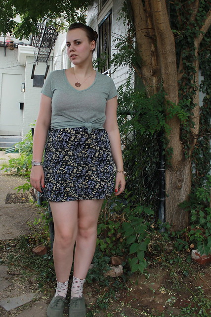Sage outfit: green t-shirt, vintage '90s mini skirt, rosette socks, canvass lace-ups, etc.