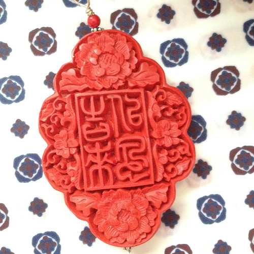 red carved wood floral oriental pendant