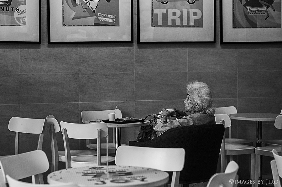 Lady with a cup of coffee.