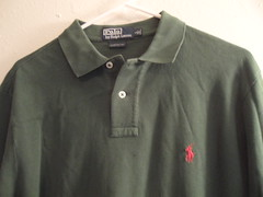 dress shirt(0.0), pocket(0.0), pattern(1.0), textile(1.0), clothing(1.0), collar(1.0), sleeve(1.0), outerwear(1.0), polo shirt(1.0), shirt(1.0),