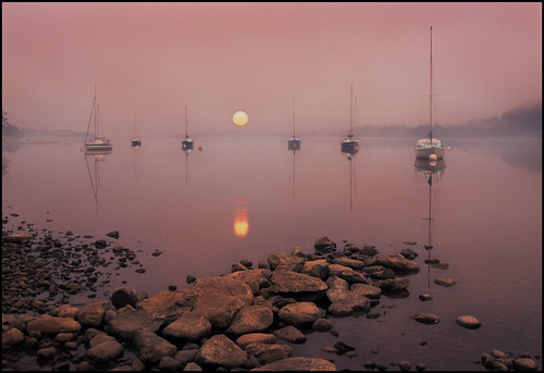 mist water fog sunrise reflections boats dawn rocks shore cumbria yachts lakeullswater