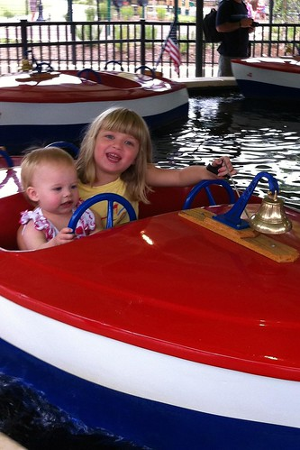 Lucy is very intent on steering. Catie is very intent on ringing the bell over and over.