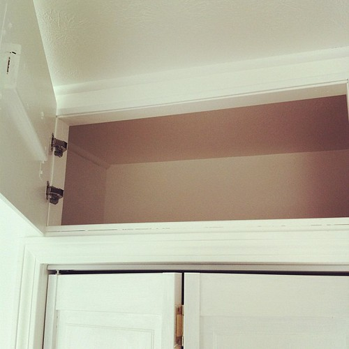 we designed storage cubbies above the closet for maximizing storage #diy #spaces #thisoldhouse #home #interiors