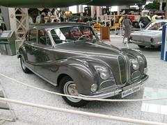 mid-size car(0.0), convertible(0.0), automobile(1.0), vehicle(1.0), automotive design(1.0), bmw 501(1.0), antique car(1.0), sedan(1.0), classic car(1.0), vintage car(1.0), land vehicle(1.0), luxury vehicle(1.0), motor vehicle(1.0),