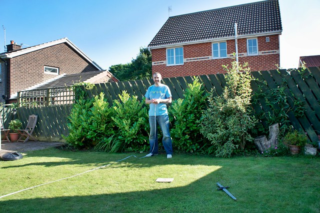 Ben (our five year-old) photographing Doug helping Mark measure the garden
