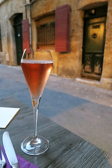 A glass of champagne before dinner in a street in Aix-en-Provence, France
