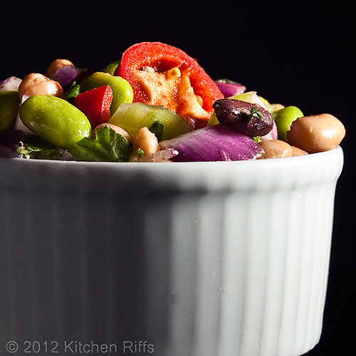 Edamame and Bean Salad in White Ramekin, Black Background